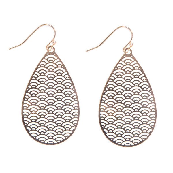 "Metal filigree teardrop shaped earring. Approximately 1.5"" in length."