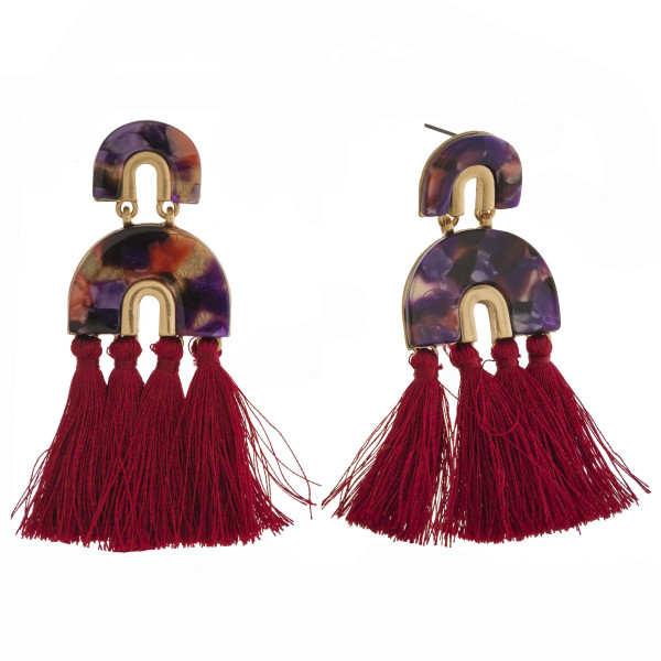 "Stud earring with acetate geometric design and soft tassels. Approximately 3"" in length."