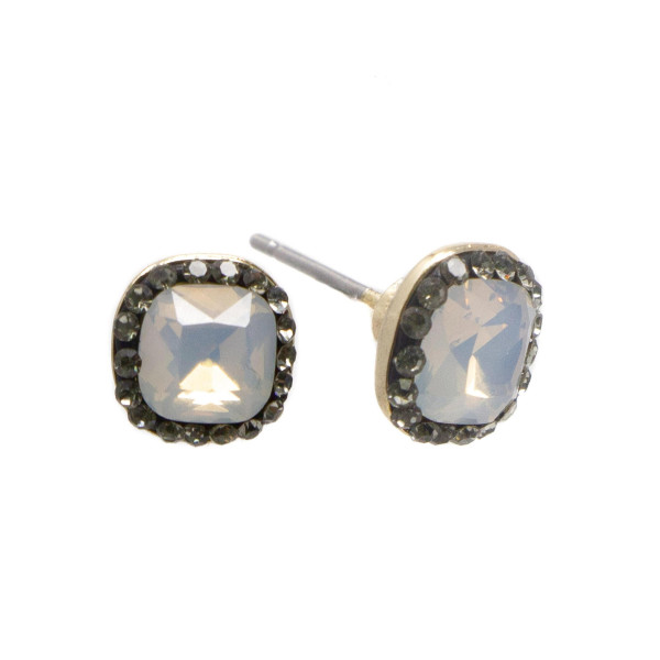 "Dainty rhinestone stud earrings. Approximately 1/4"" in length."