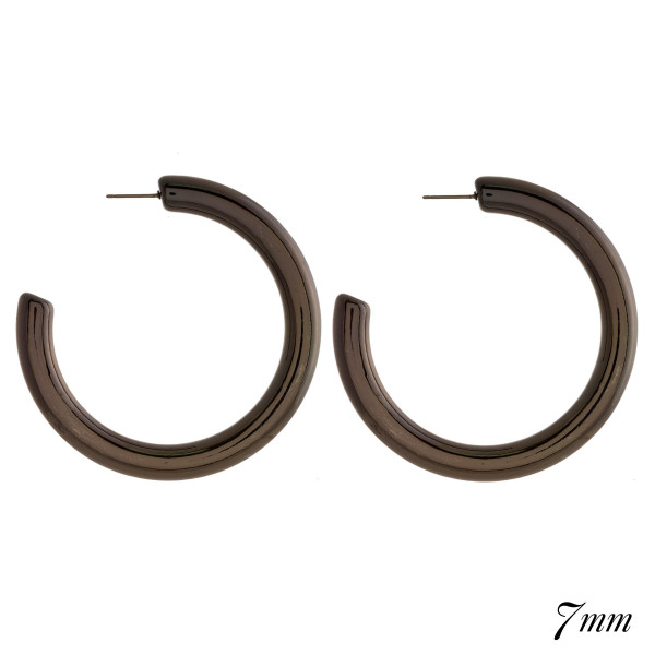 "Chunky hoop earring. Approximately 2.5"" in diameter with a 7mm thickness."