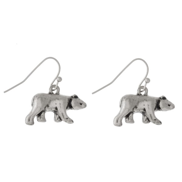 """Metal fishhook earring with bear shape. Approximately 1"""" in length."""