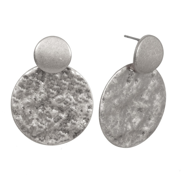 "Stud metal earring with hammered circle. Approximately 1.5"" in length."