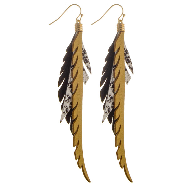 Long feather detail with black and white print detail. Approximate 3.5 in length.
