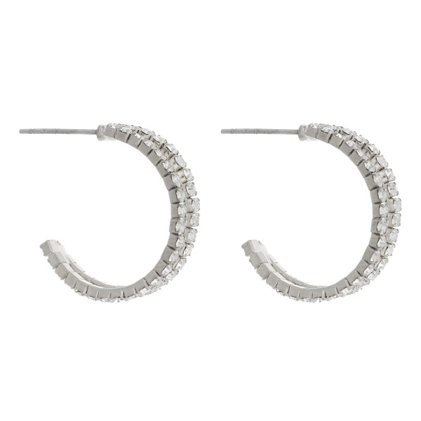 """Round metal hoop earrings with """"Star"""" charmed. Approximate 1"""" in diameter."""