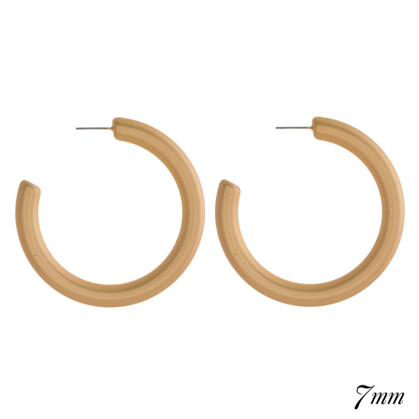 """Chunky hoop earring. Approximately 2.5"""" in diameter with a 7mm thickness."""
