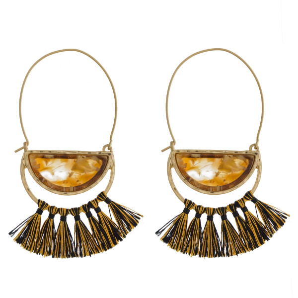 """Gold tone fishhook earring with acetate and tassel detail. Approximately 3"""" in length."""