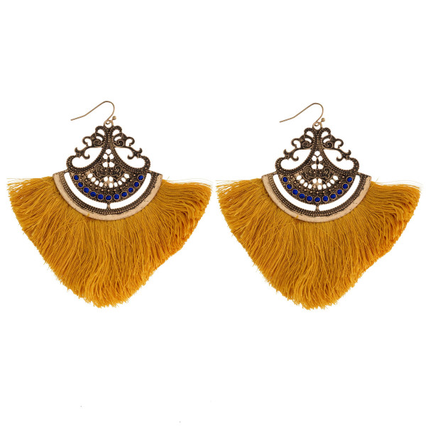 "Gold tone fishhook earring with fanned tassel. Approximately 3"" in length."