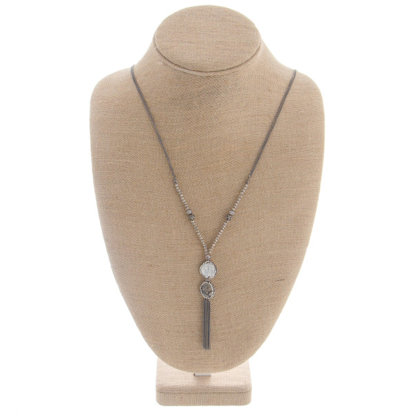 """Long metal necklace featuring a 2 stone pendant with rhinestone details with tassel. Approximate 38"""" in length with a 3.0"""" pendant."""
