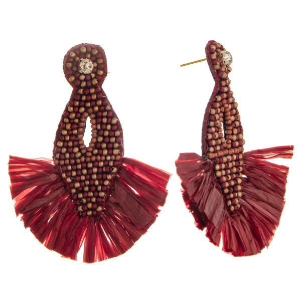 "Long beaded earring with rhinestone and fanned details. Approximate 2.5"" in length."