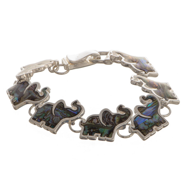 "Sliver bracelet with elephant charms. Approximate 7.5"" in length."
