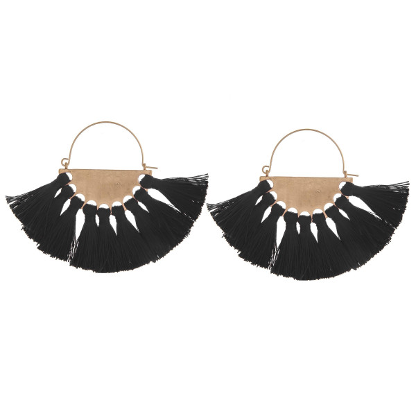 Enjoy these gold metal earrings with tassel details. Approximate 2.5 in diameter.