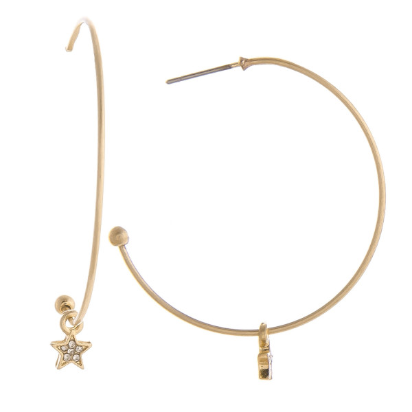 "Gorgeous metal hoop earrings with little star charm along the hoop. Approximate 1.5"" in diameter."