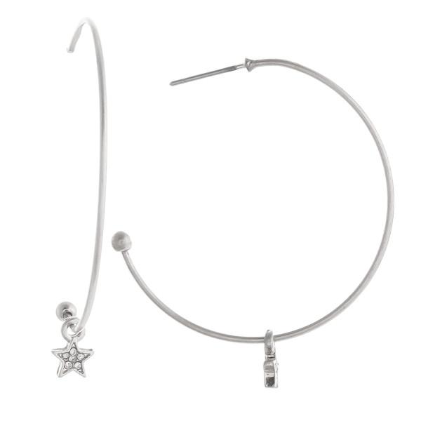 "Gorgeous metal hoop earrings with little star charm along the hoop. Approximate 1.5"" in diameter."