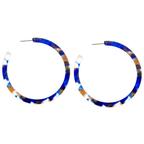 Long open hoop acetate earring. Approximate 1.5 in diameter.