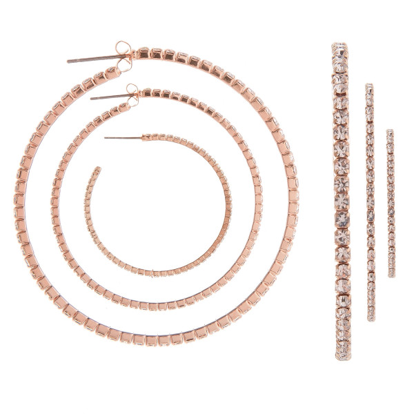 "You won't go wrong with these gorgeous hoop earrings. Gives that perfect Bling! Comes with one small- One medium hoop- One large hoop. Approximate Large hoop 3"" in diameter- Medium hoop 2"" in diameter and small hoop 1"" in diameter."