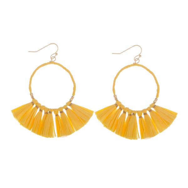 """Long fishhook hoop earrings with tassel details. Approximate 2"""" in length."""