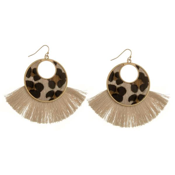 "Long hoop earrings with animal print detail and tassel. Approximate 2.5"" in length."