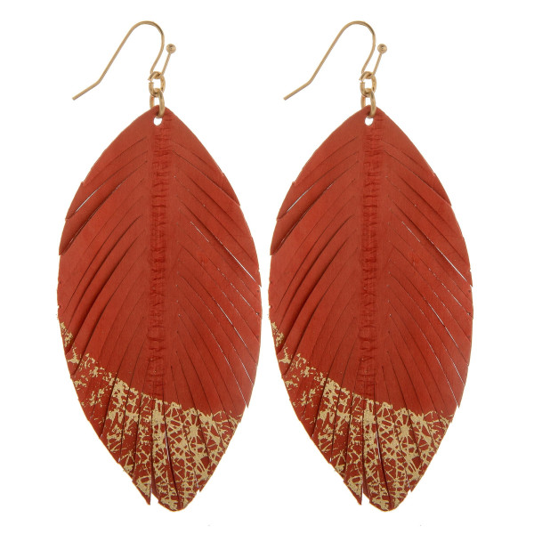 "Gorgeous genuine leather  earring with glitter detail. Approximate. 3.5"" in length."
