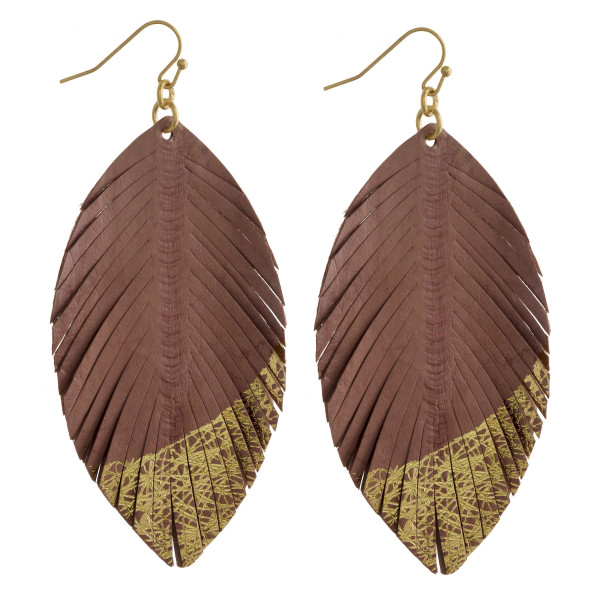 "Leather earring with glimmer detail. Approximate 3.5"" in length."