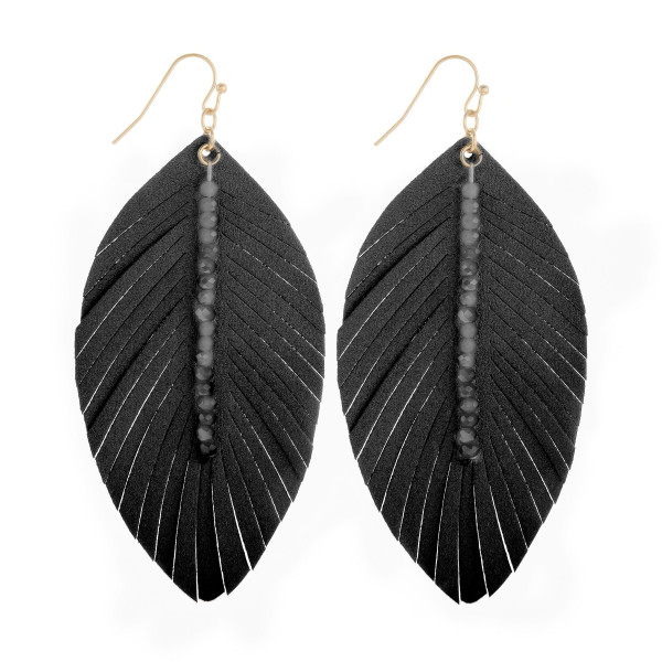 """Long leather leaf earring with bead detail. Approximate 3"""" in length."""