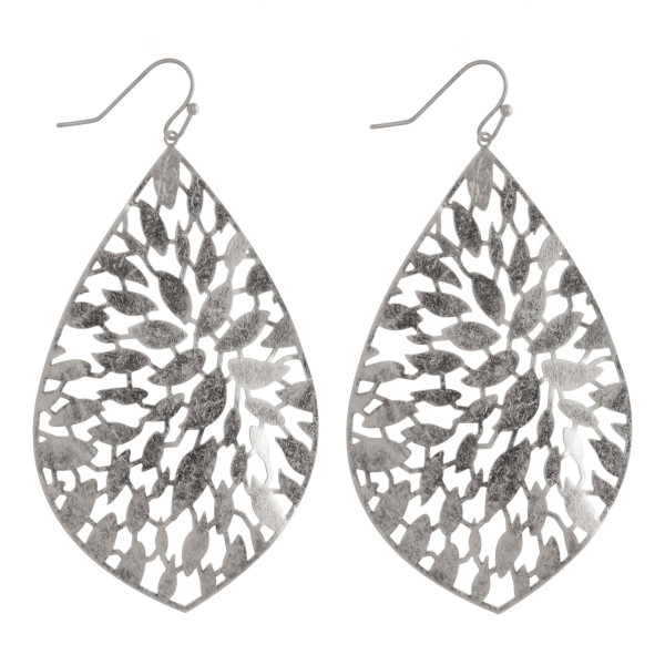 Long metal drop earrings with cut-out details. Approximate 2.5 in length.