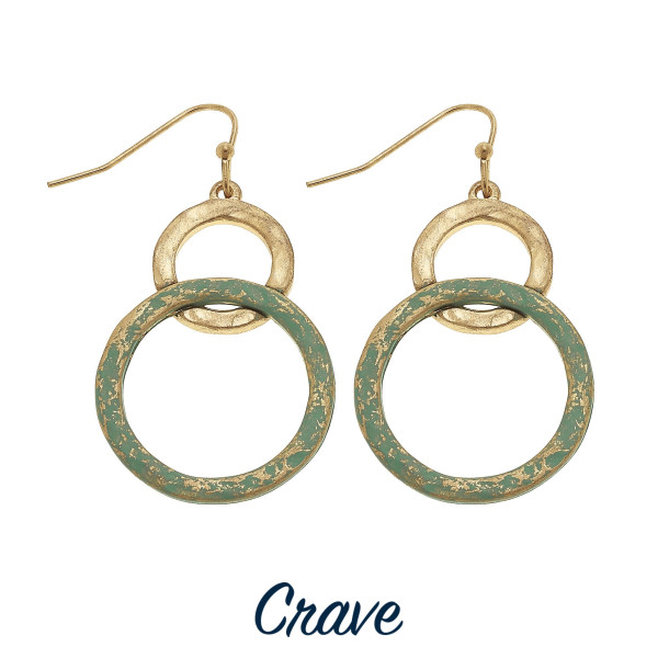"Hammered metal nested circle drop earrings with patina finish details. Approximately 1.5"" long."