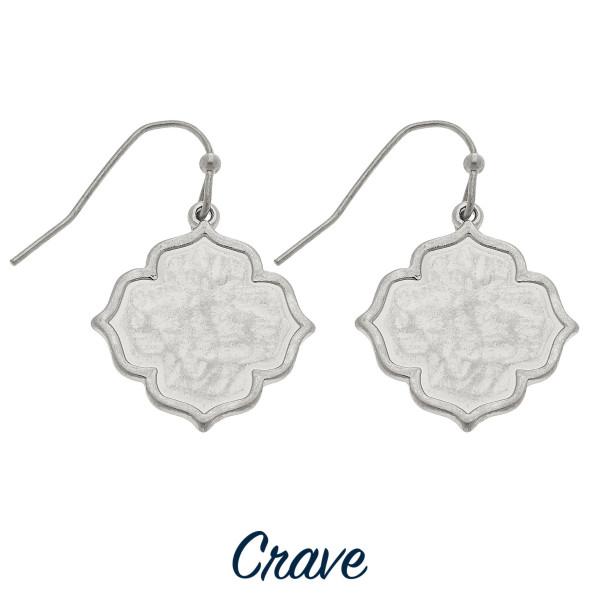 "Dainty quatrefoil shaped drop earrings. Approximately 3/4"" tall."