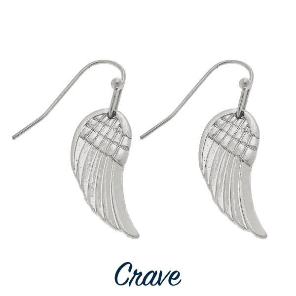 "Dainty angel wing drop earrings. Approximately 3/4"" tall."