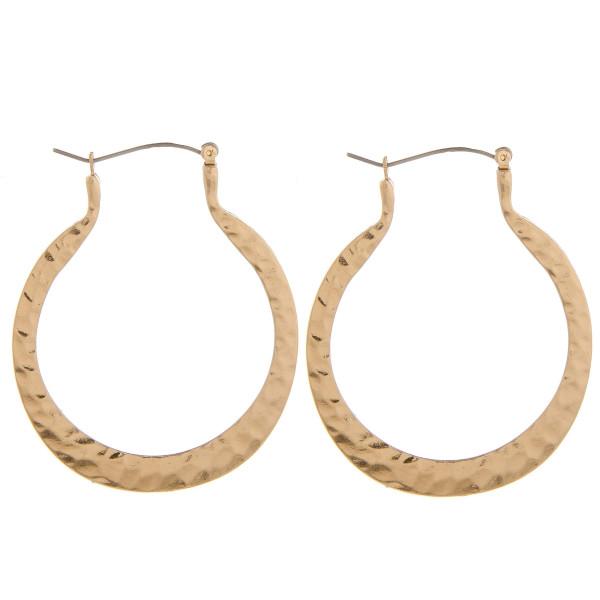 """Long hoop earring. Approximate 2"""" in length."""