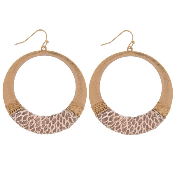 """Circular earring with a snakeskin leather wrap detail. Approximately 2"""" in diameter."""