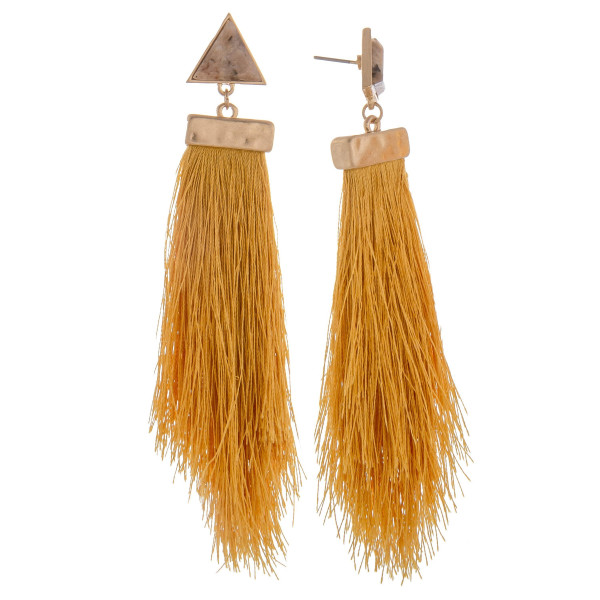 "Long tassel earring with triangle  stud detail. Approximate 4"" in length."