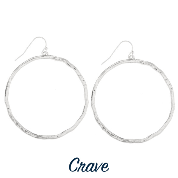 "Hammered circle dangle earrings. Approximately 1.75"" in diameter."