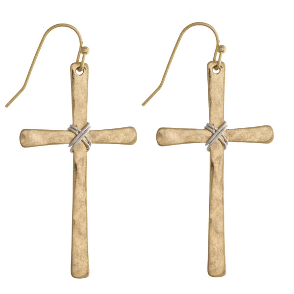 "Long metal fishhook cross earrings with gold detail. Approximate 2.5"" in length."