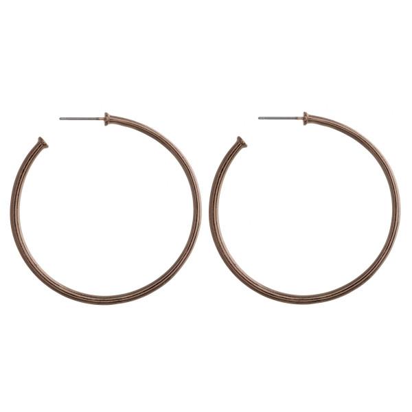 """Long metal hoop earring. Approximate 2"""" in length."""