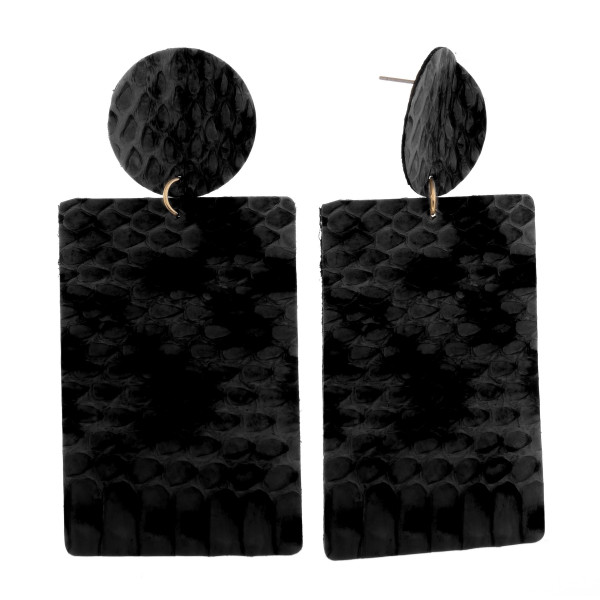 """Long leather earring with animal print. Approximate 3"""" in length."""