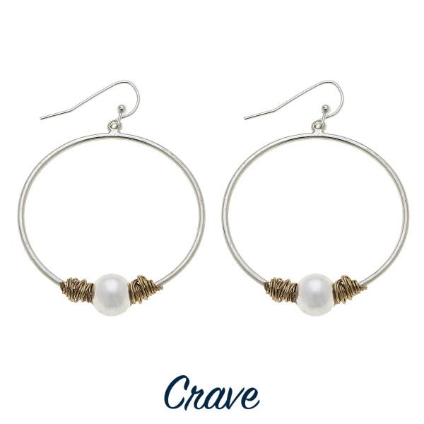 """Long metal hoop earring with pearl detail. Approximate 2"""" in diameter."""