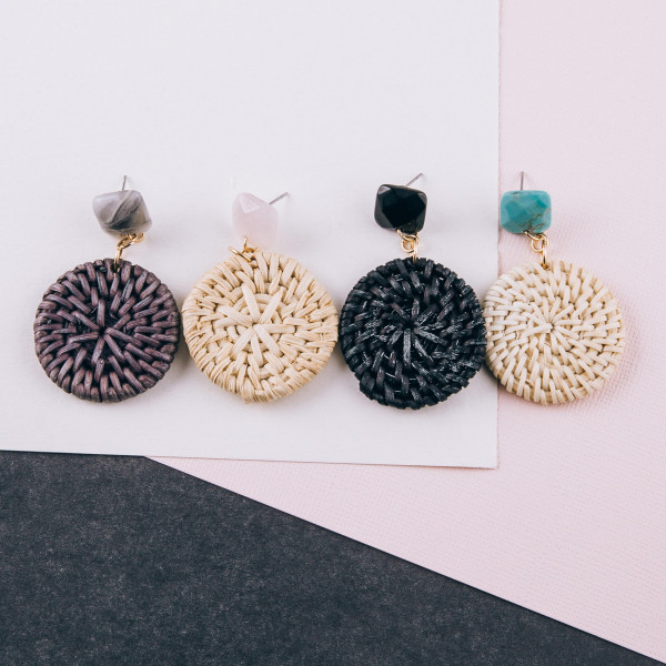 "Rattan woven disc earrings featuring a natural stone stud accent. Natural raffia may vary in shade and tone. Approximately 2"" in length."