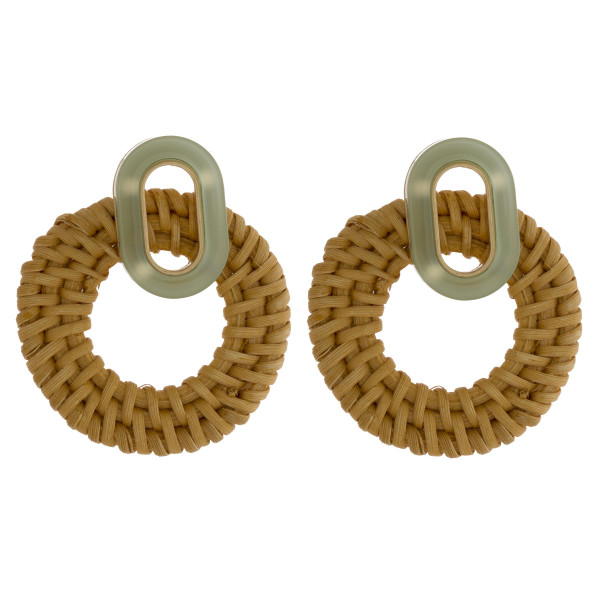"Woven raffia hoop earrings with acetate post. Approximately 2"" in length."