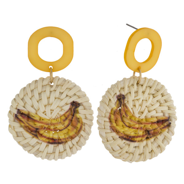 "Long woven raffia earrings with acetate post and banana fruit print. Approximately 2"" in length."