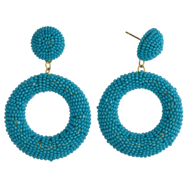 """Long seed beaded hoop earrings. Approximate 2"""" in length."""