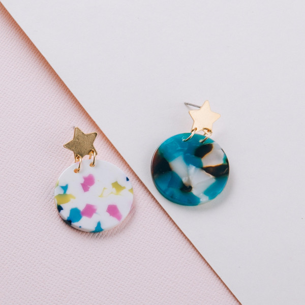 """Resin inspired earrings with a gold star stud post. Approximately 1"""" in diameter."""