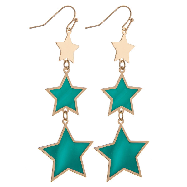 "Drop metal earrings featuring green and gold star accents. Approximately 2.75"" in length."