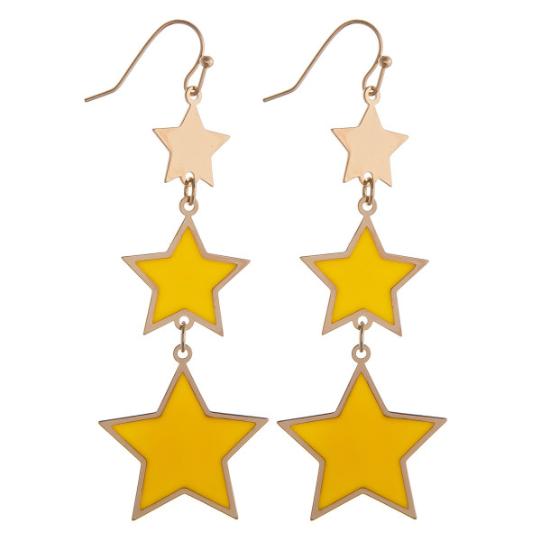 "Drop metal earrings featuring yellow and gold star accents. Approximately 2.75"" in length."