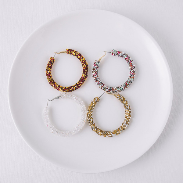 "Large hoop earrings featuring multicolor and silver rhinestones. Approximately 2"" in diameter."