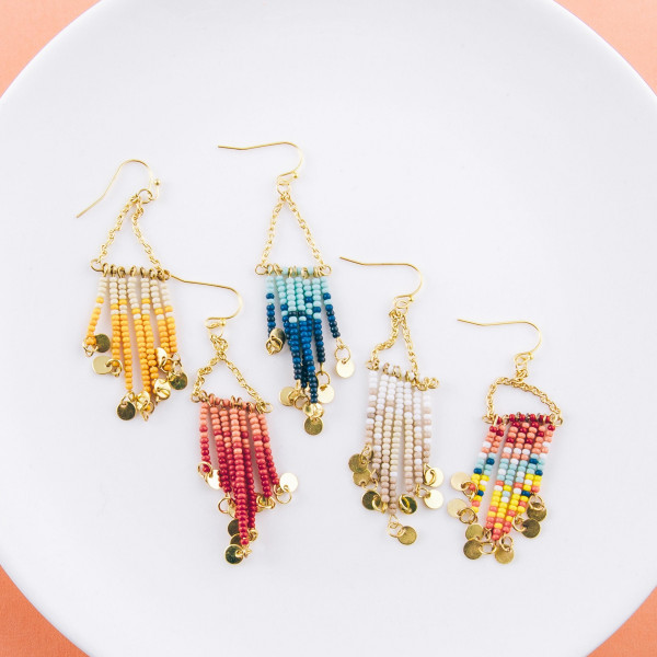 """Long drop earrings featuring beaded tassel details with gold disc accents. Approximately 3"""" in length."""