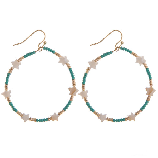 "Circular drop earrings featuring turquoise beads and star accents. Approximately 1.5"" in diameter."
