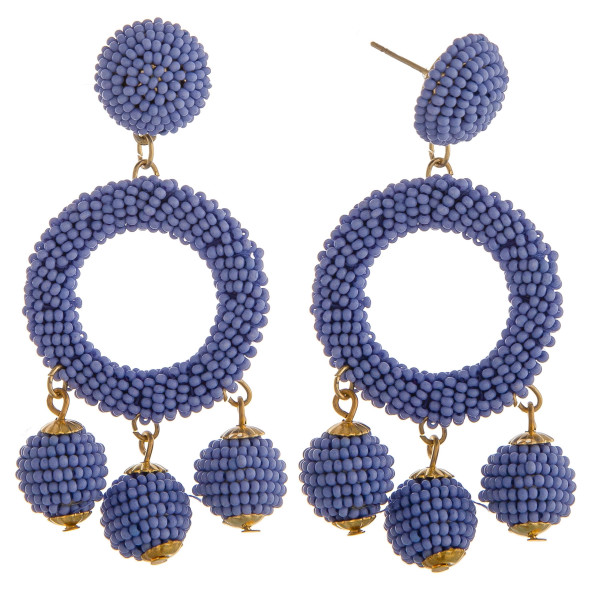 "Blue circular drop earrings featuring hanging beaded accents with a stud post. Approximately 2.5"" in length."