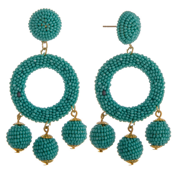 """Turquoise circular drop earrings featuring hanging beaded accents with a stud post. Approximately 2.5"""" in length."""