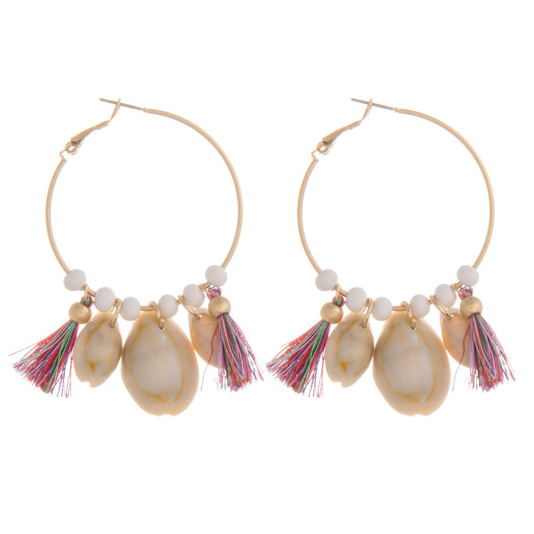 """Long hoop earring with bead, tassel and seashell details. Approximate 2.5"""" in length."""