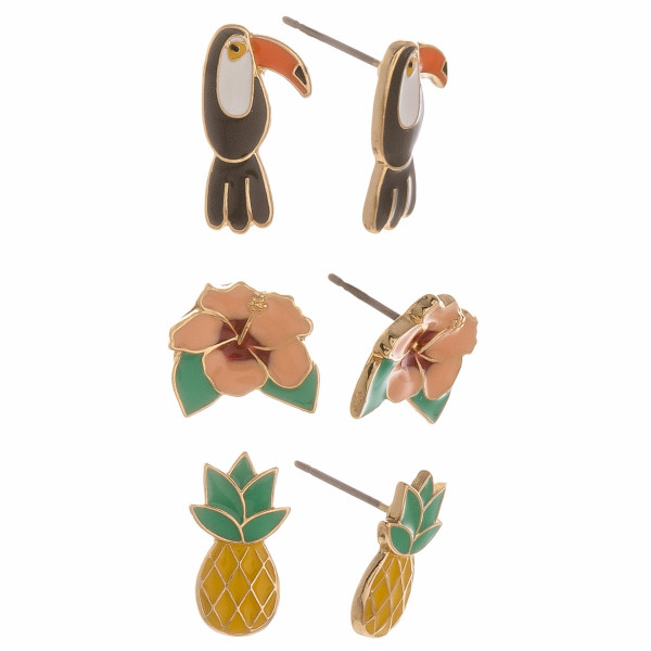 Set of 3 pairs of tropical themed stud earrings featuring toucans, flowers, and pineapples.